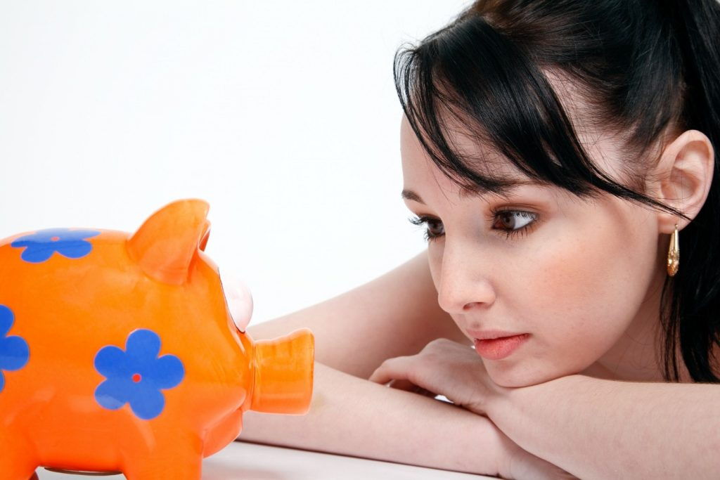 piggy-bank-saving-money-young-woman-finance
